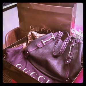 Brown leather Gucci purse in MINT condition